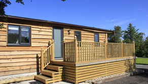 Construction of two sections of caravan on-site accepted as lawful