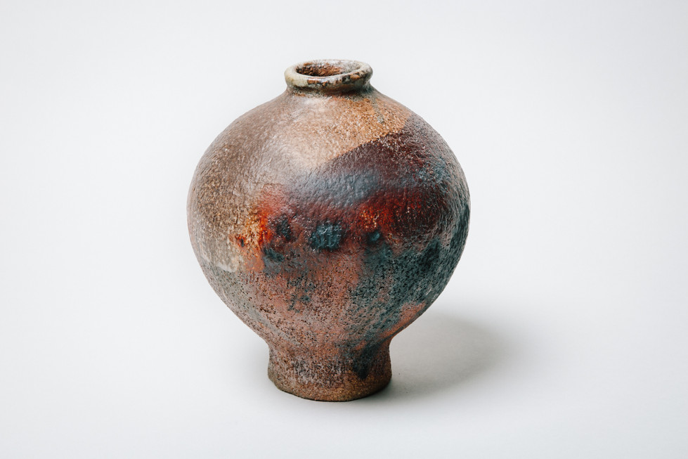 Cosmic jar with red glow, brian holland.