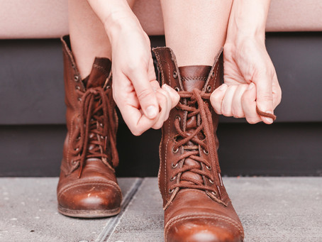 A Girl in Tattered Boots