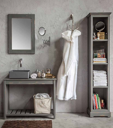 Bathroom featuring a grey resin decorative basin on a wooden grey bathrom cabinet, matched up with a grey wooden mirror and storage unit.