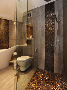 elegant-bathroom-tiles-design-with-gold-and-black-hexagonal-tiles-also-gray-tile-and-floor-and-white-modern-toilet-and-white-bathtub-also-modern-faucet-and-shower-head-also-gl.jpg