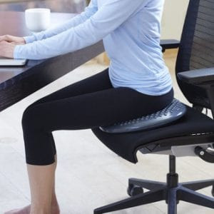 """Dynamic or Active Sitting"" on a balance cushion."
