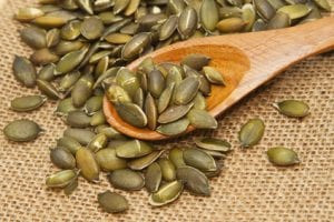 Pumpkin seeds in wooden spoon