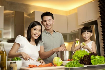 Asian Family Eating Greens