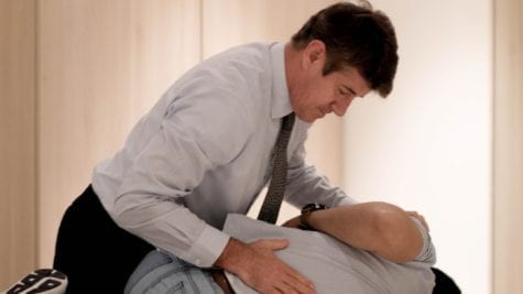 Dr Tim giving a chiropractic adjustment
