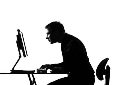 silhouette man computing with poor posture