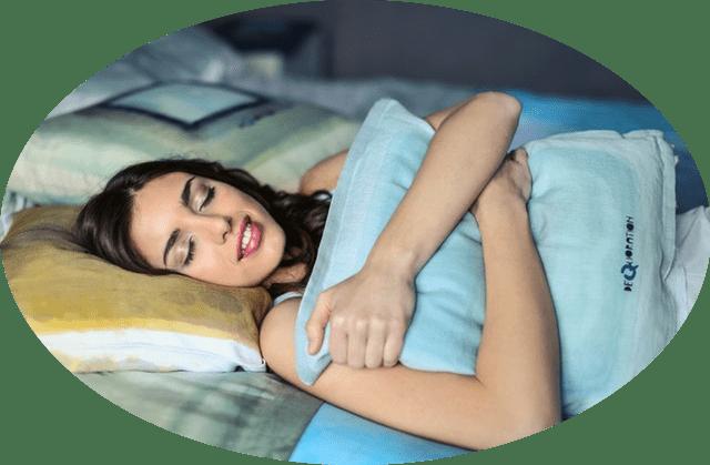 Women sleeping on comfortable bed