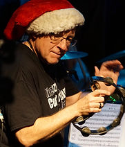 Jazz Consortium Big Band director Roy with Santa hat & tambourine