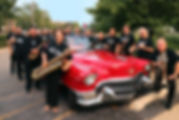 Two classics: a red '55 Cadillac convertible and the Jazz Consortium Big Band!