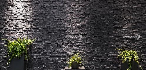 Wandgestaltung mit schwarzer Kunststeinpaneele Fiji von Artstone Panel Systems