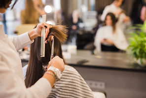 brunette-woman-getting-her-hair-cut.jpg