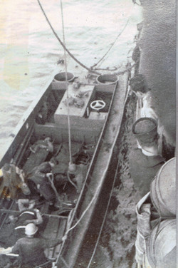 USS LST-388 Taking Wounded Aboard
