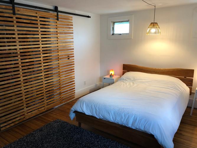 Cherry bed and reclaimed lath door
