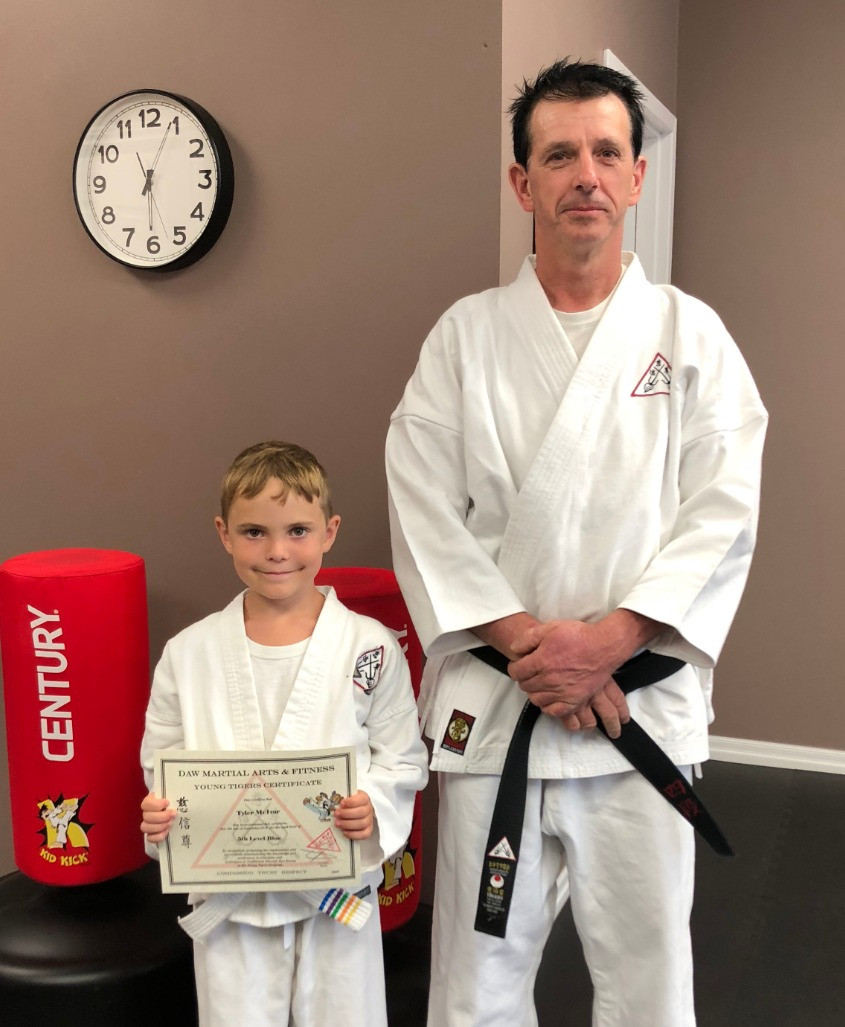 Sensei with Tyler holding certificate