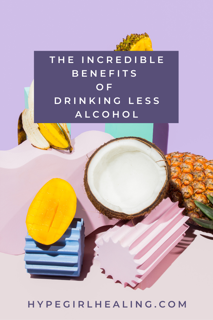 Pale pink and blue background with a halved coconut and mango for the benefits of sobriety