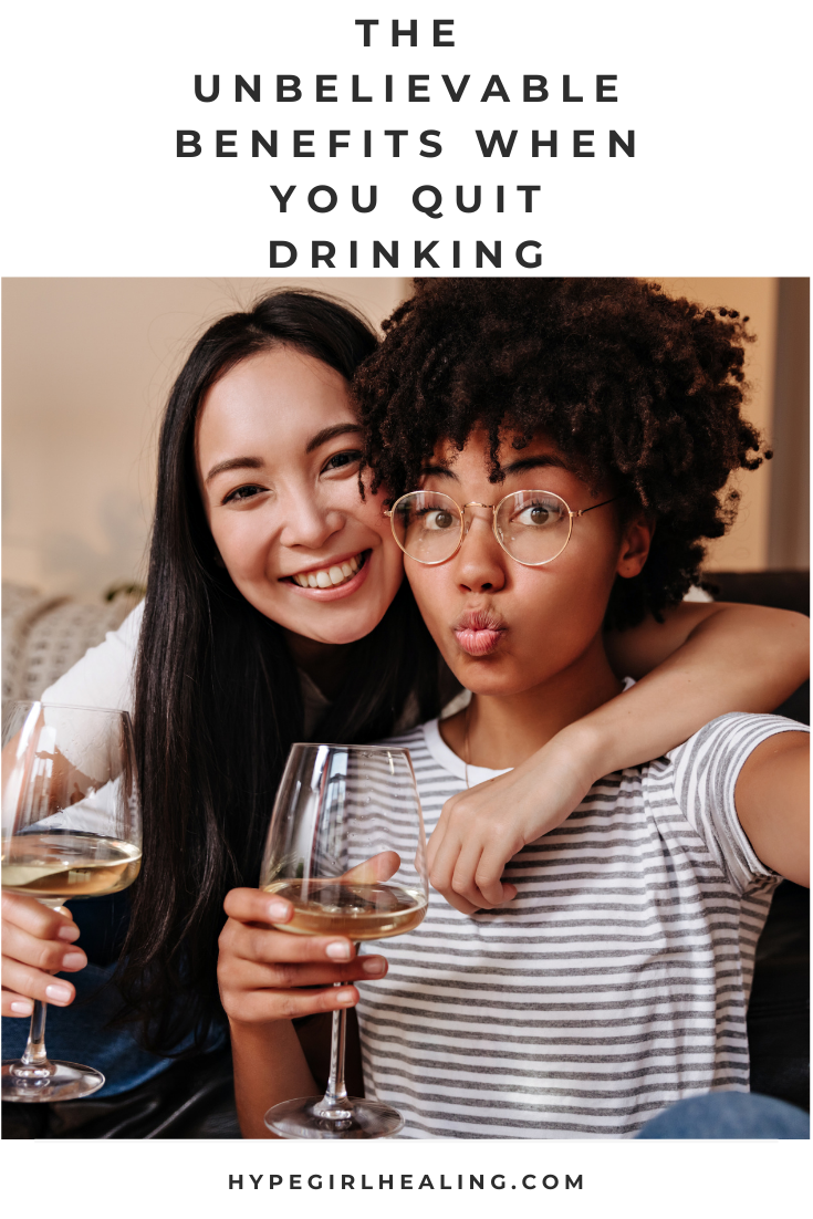 Two girls with white wine sitting on a couch, wanting to show the benefits of not drinking
