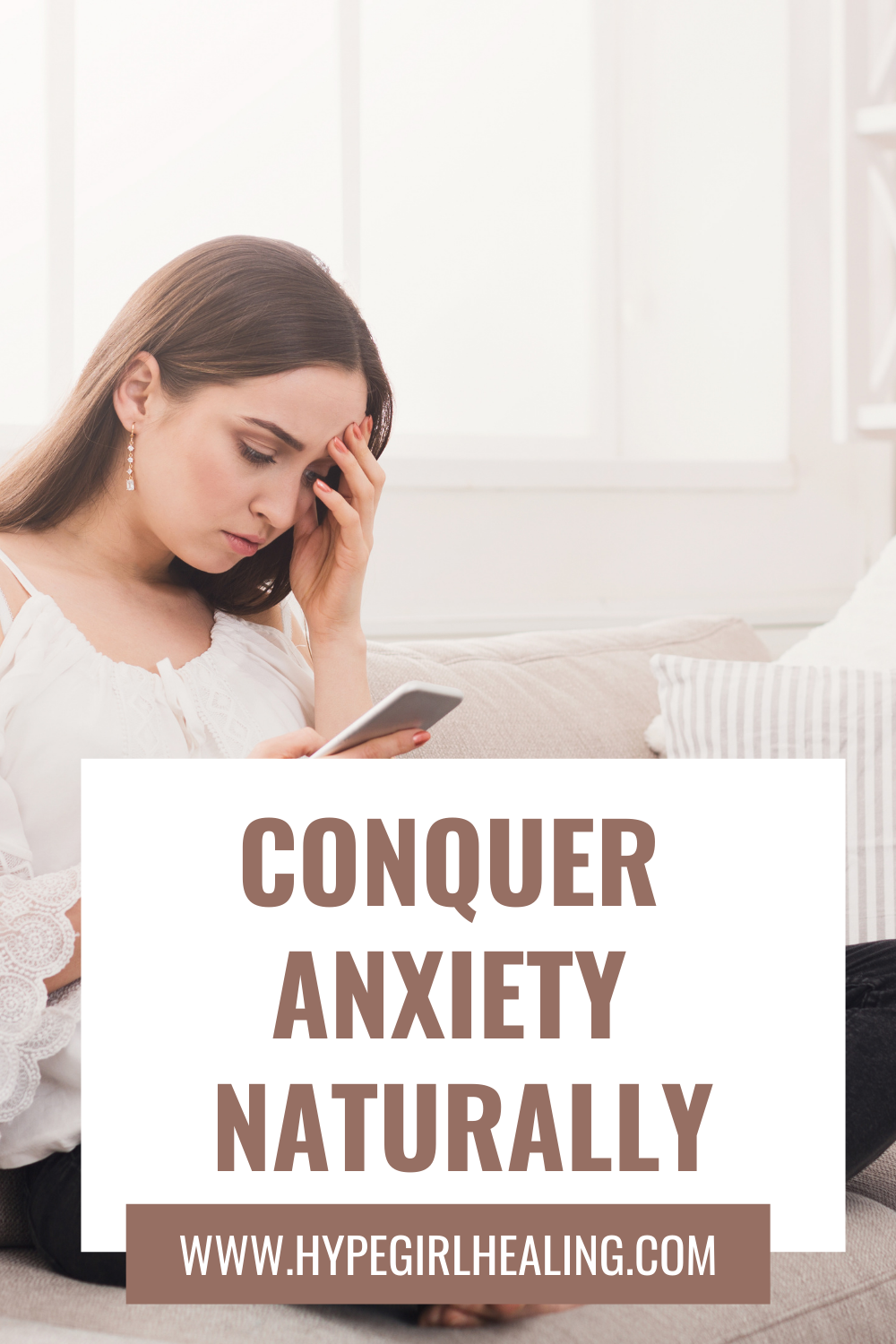 Girl sitting on couch looking at phone  and hand on forehead, feeling anxiety