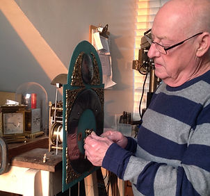 Man fixing a grandfather clock at our shop near St. Ives in Cambridgeshire