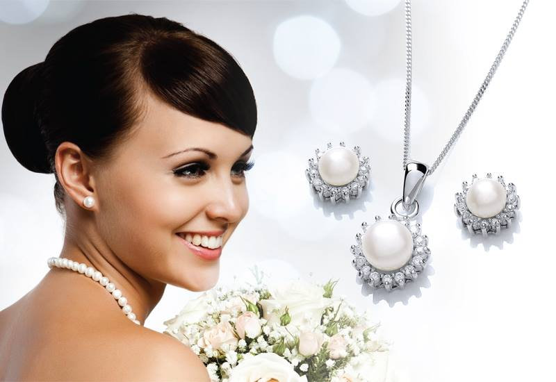 Lady in wedding gown modelling our pearl and diamond wedding jewellery on sale in our shop in Ramsey Cambridgeshire