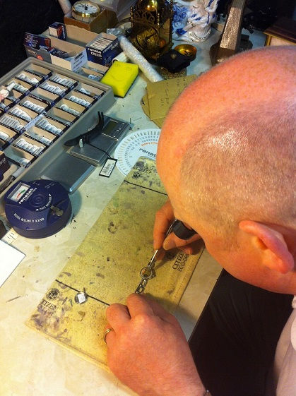 A man fixin a watch and fitting a new battery at our jewellers in Ramsey Cambridgeshire