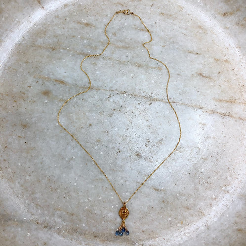 Green sapphire and gold pendant necklace