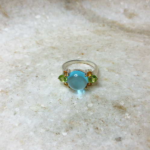 Blue topaz flower silver ring