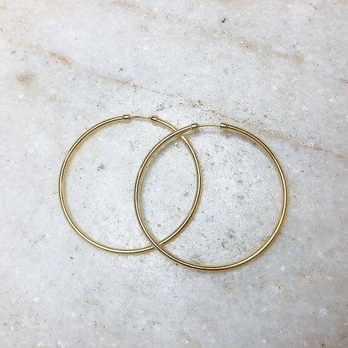 Medium gold hoop earrings