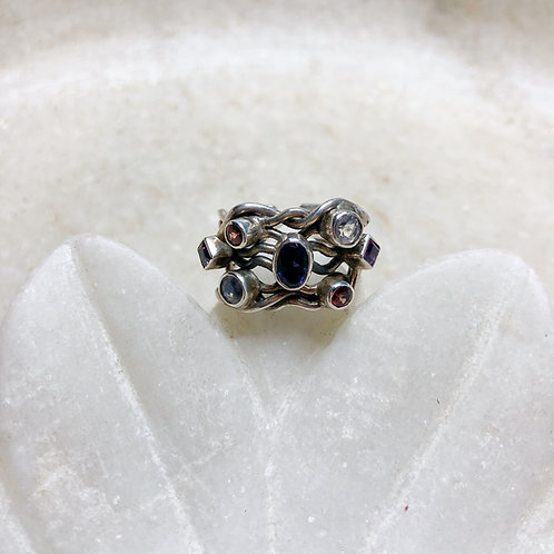 Jewels in a net silver ring