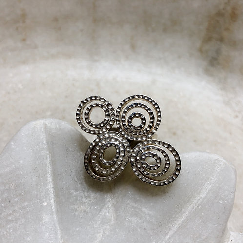 Swirling silver circles ring