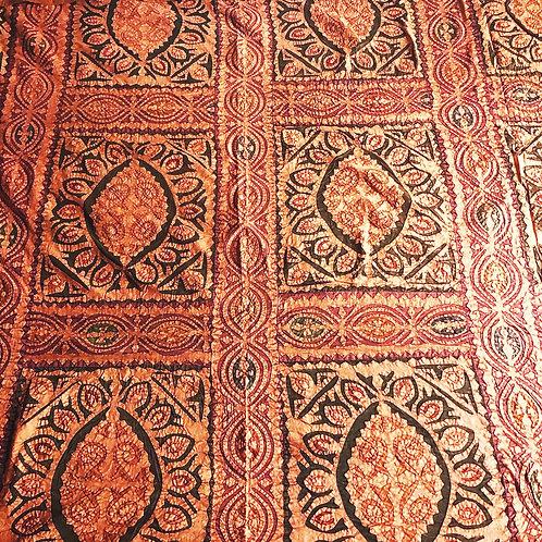 Deep orange cutout bedspread
