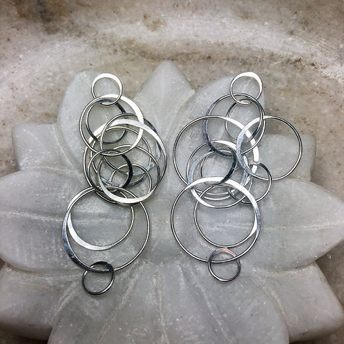 Tumbling circles silver post earrings
