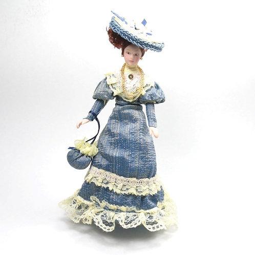 Boneca vestido azul