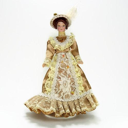 Boneca vestido dourado