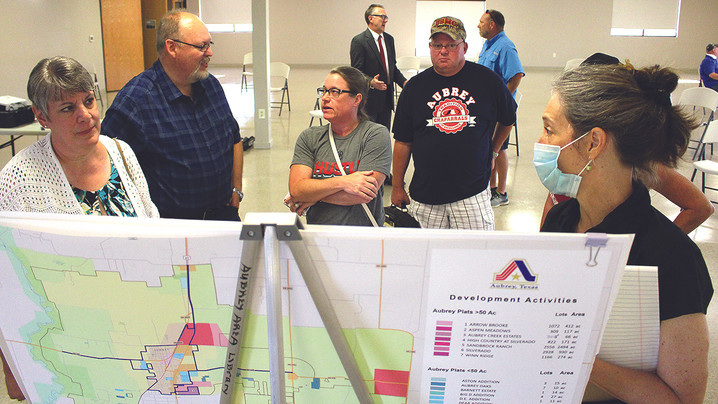 Aubrey looks at land use plan with residents