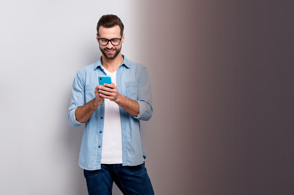 Email Designs. Man on his mobile phone sending an email