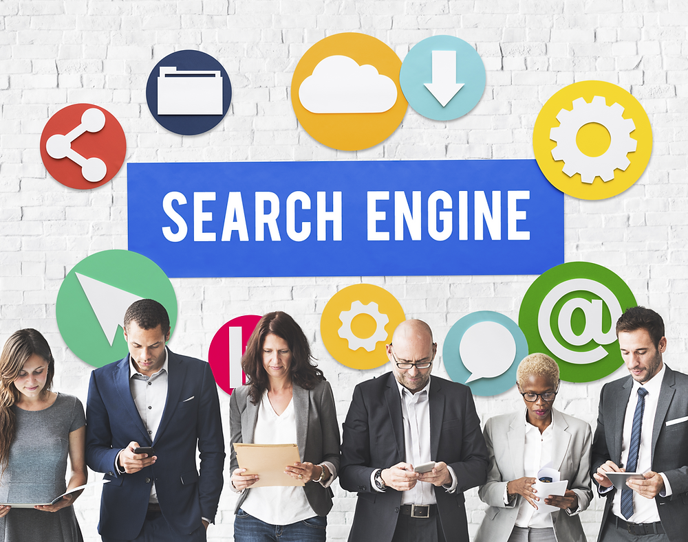 6 people looking on laptops, mobiles and tablets for SEO