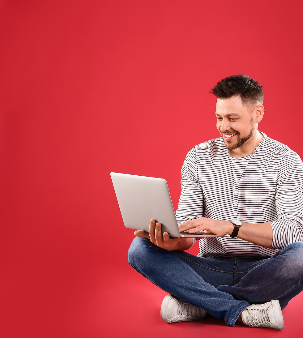Website Designs. Man on a laptop looking at our services.