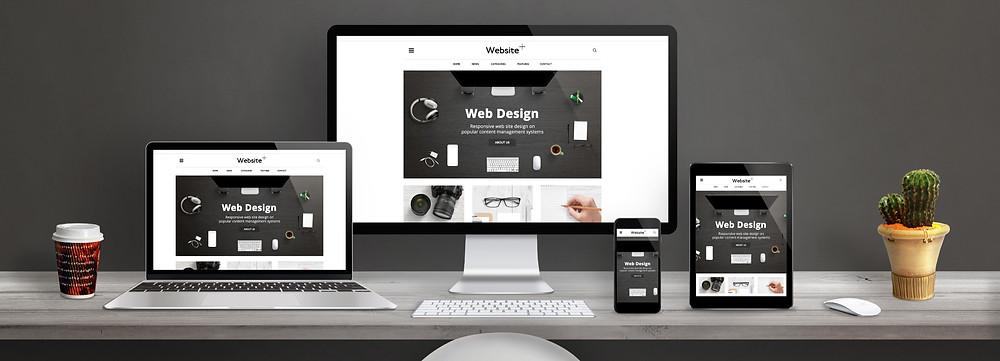 Responsive Website Design on a laptop, desktop, mobile and tablet.