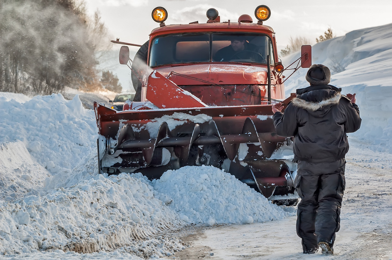 Worker-controls-snow-cleaning-process-53