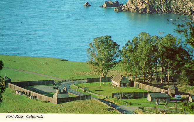 Postcard of Fort Ross showing Hwy 1 paved through the fort
