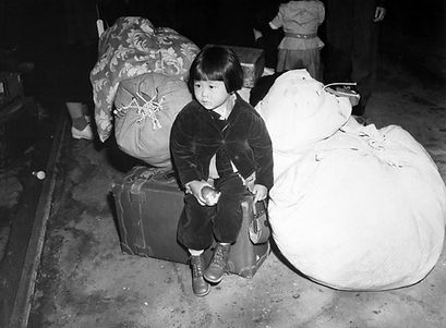 Two-year-old Yuki Okinaga Hayakawa waits at Union Station for train headed to Manzanar War Relocation Center