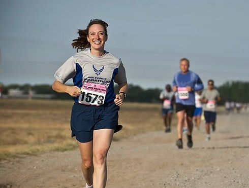 woman-in-gray-crew-neck-shirt-running-on-brown-soil-during-34495_edited_edited.jpg