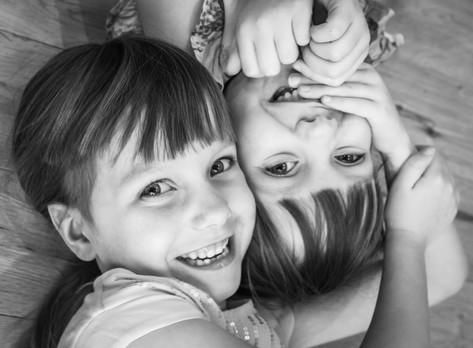 Twin girls giggling