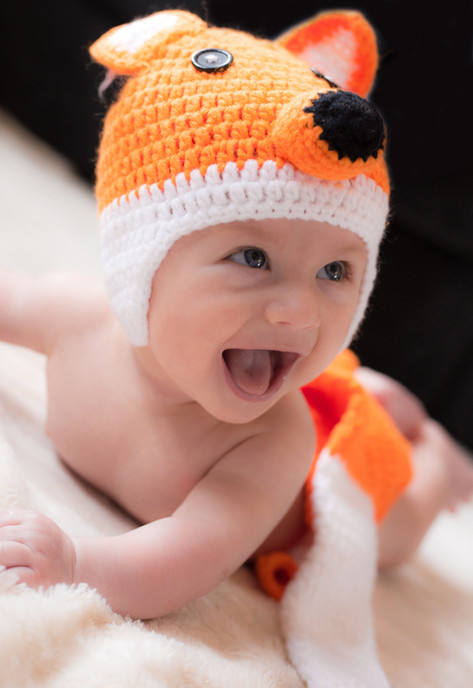 Cute baby in fox hat
