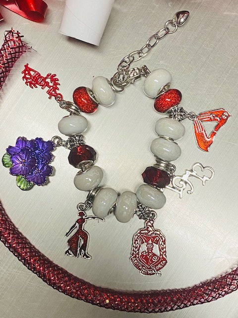Essence of a Delta Charm Bracelet