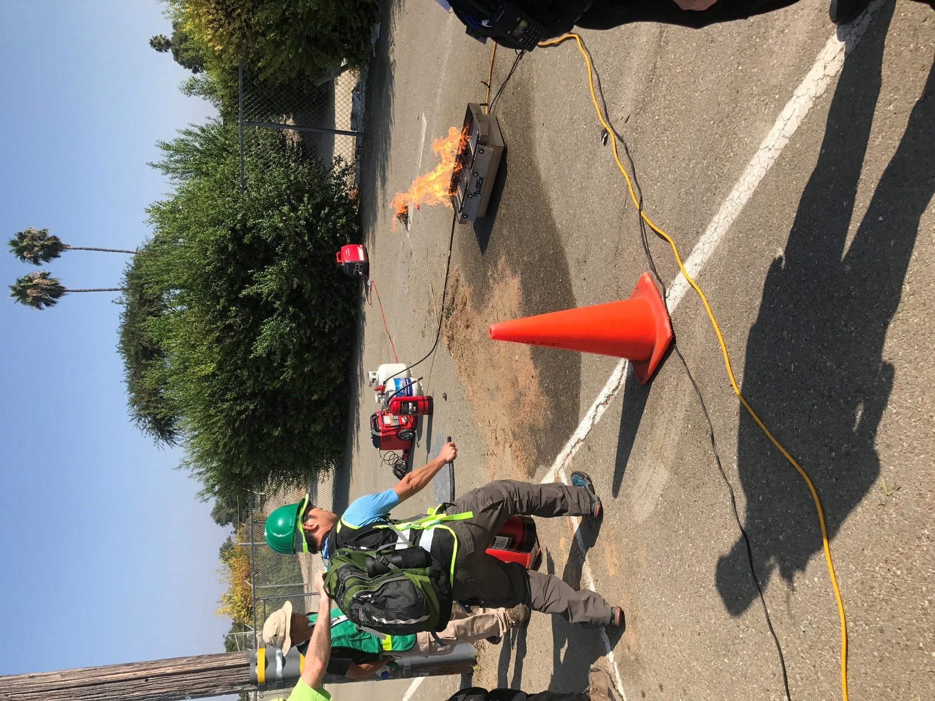 CERT student using fire extinguisher