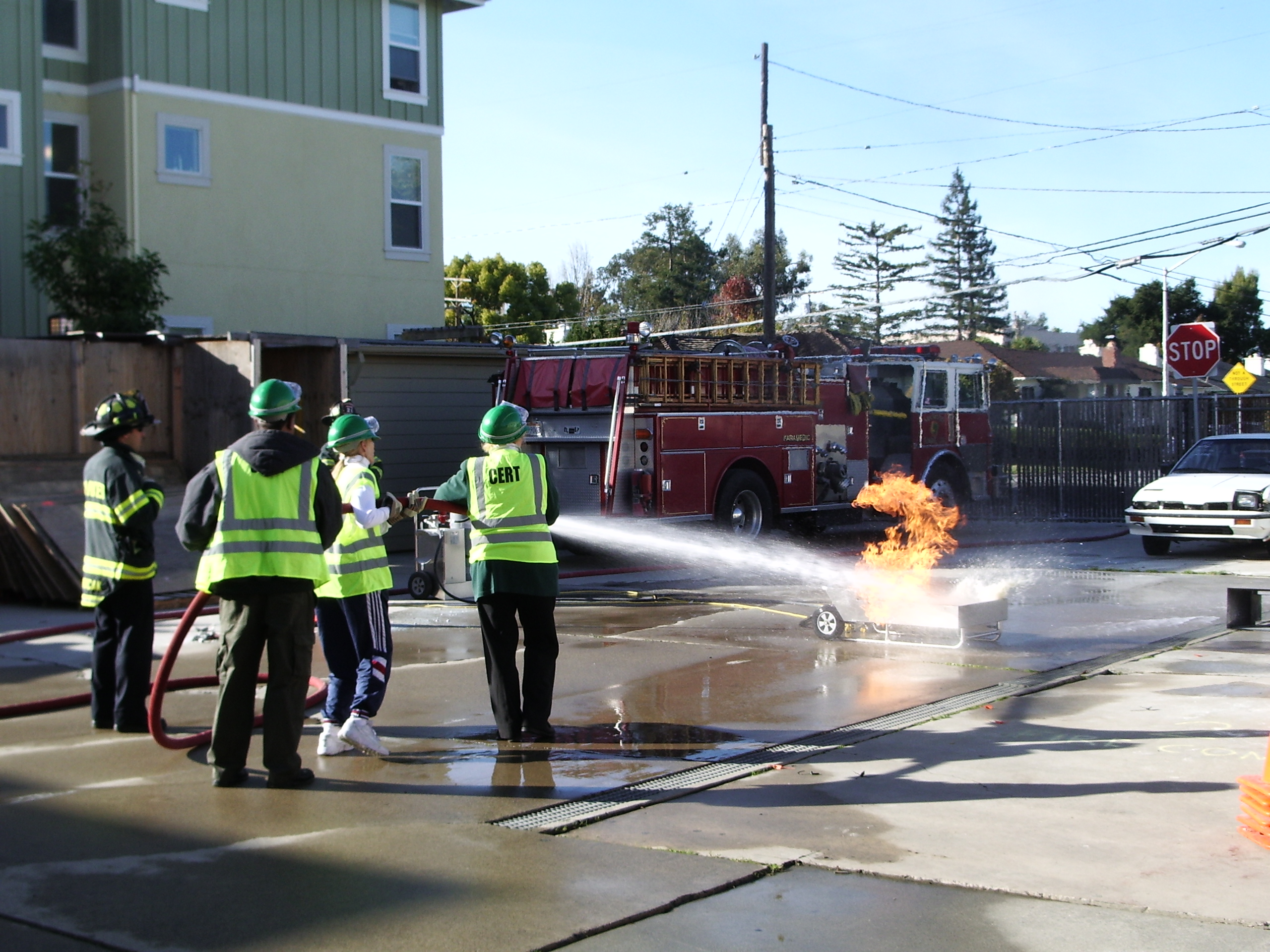 CERT students using fire hose