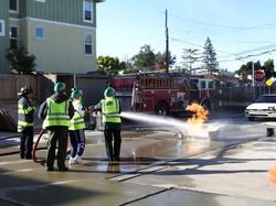CERT students using fire hose