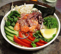 Poke bowl! This is our pacific inspired Salmon and Tuna dish with seaweed and sesame dressing !