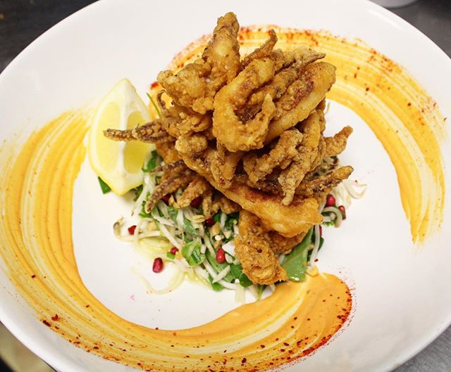 How good is our Spicy Fried Squid_! 🐙 This lil beauty sits on a delicious fresh green papaya salad